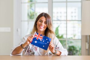 changes to citizenship test, woman holding australian flag